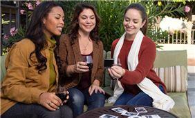 Girls Enjoying Wine In Pool Area